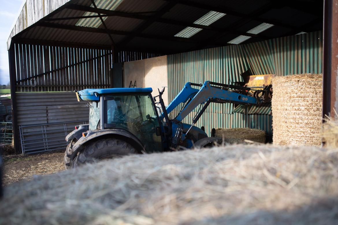 The tractor crashes through the barn and into Rhona