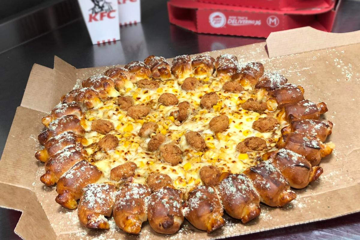 KFC and Pizza Hut have made a popcorn chicken and gravy pizza