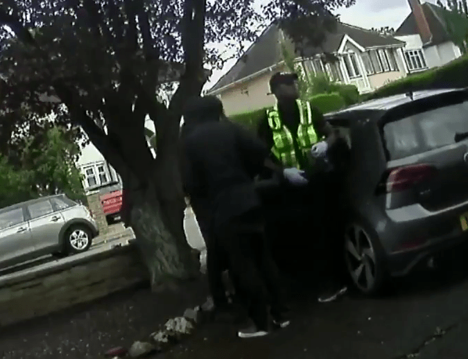 The group of four men stormed the home, stealing phones and a wallet