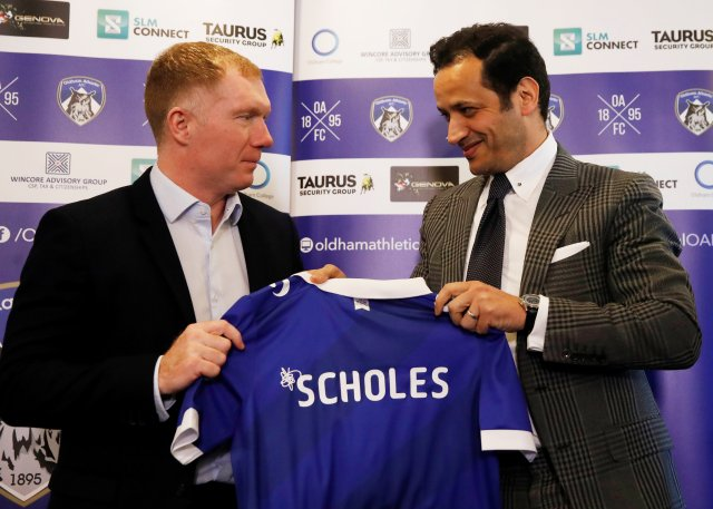 Oldham owner Abdallah Lensagam has hit back at Paul Scholes for quitting as manager by text