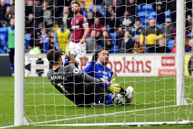 Victor Camarasa bundles the ball over the line to double the Cardiff lead over West Ham