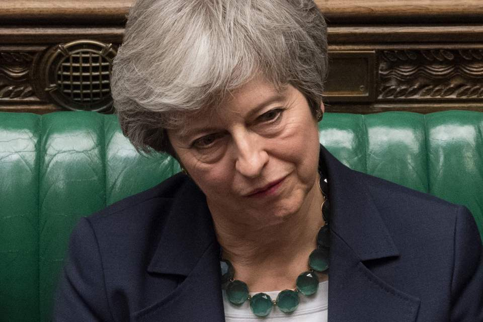 Theresa May reacting on the front bench in the House of Commons