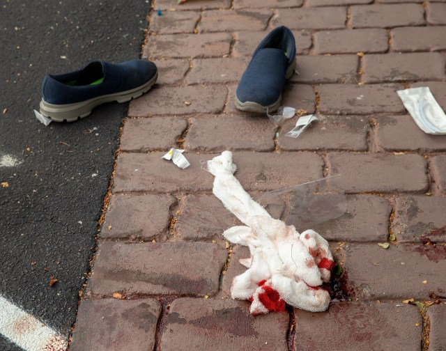 Bloodied bandages are seen on the ground outside the Masjid Al Noor mosque