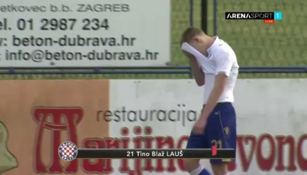 A distraught Laus trudges off the field after scoring the third in a 3-1 win for his side