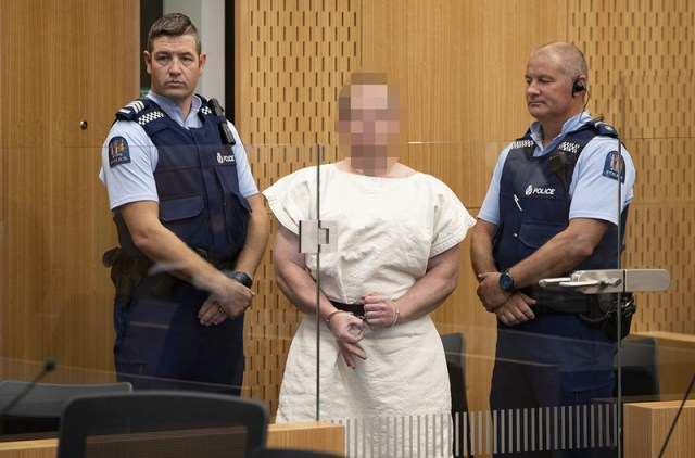 Brenton Harrison Tarrant, 28, made a white power symbol as he appeared in court charged with murder