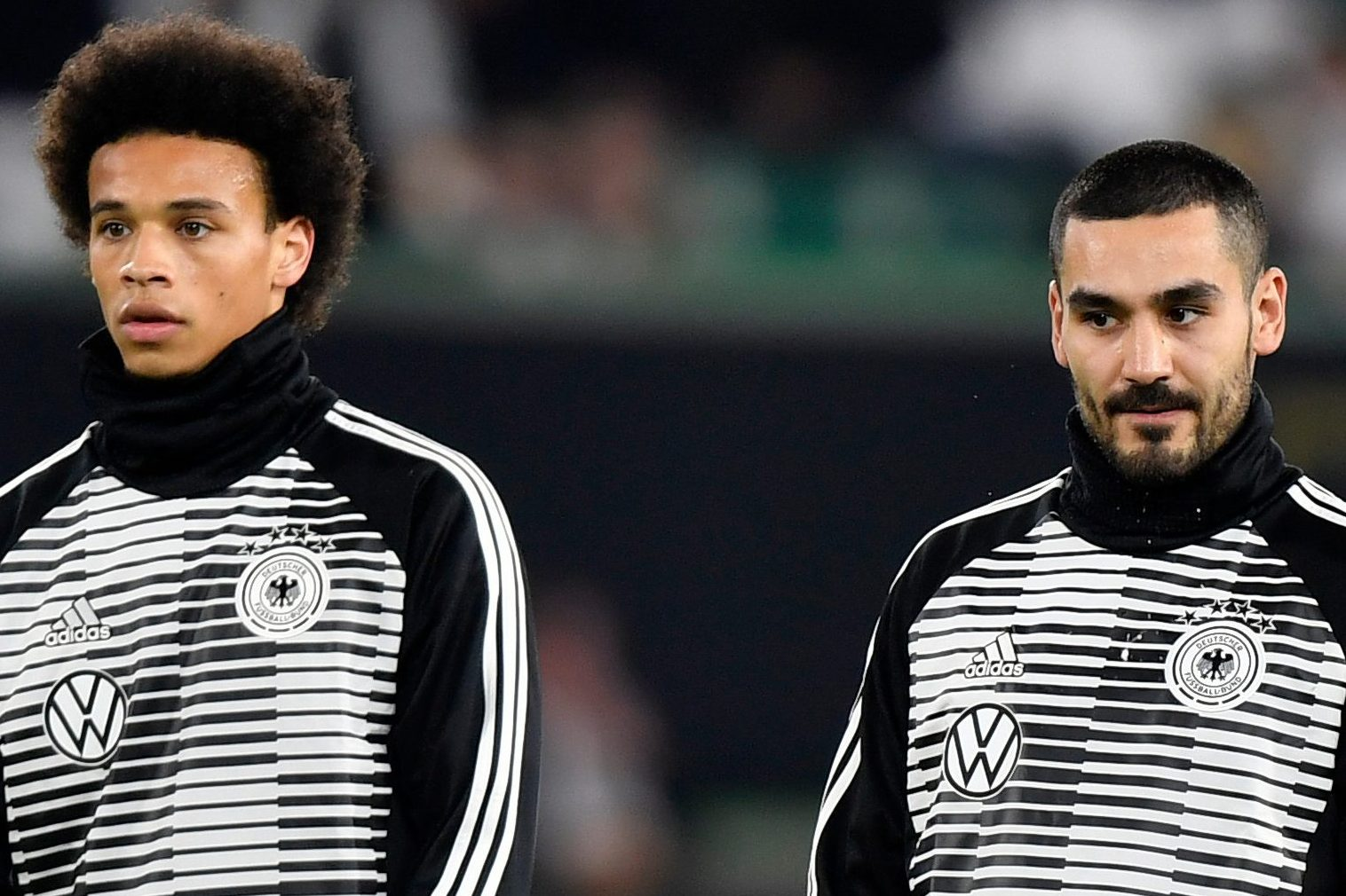Three men turn themselves into police after racially abusing Leroy Sane and Ilkay Gundogan in Germany's draw with Serbia