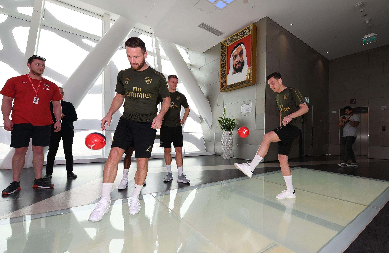 Arsenal squad having fun at the Dubai Frame