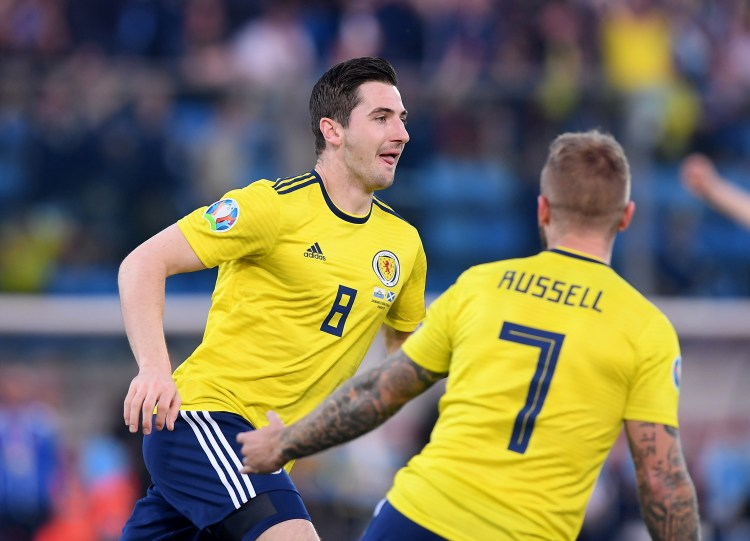 Kenny McLean wheels away after scoring the game's opening goal against San Marino
