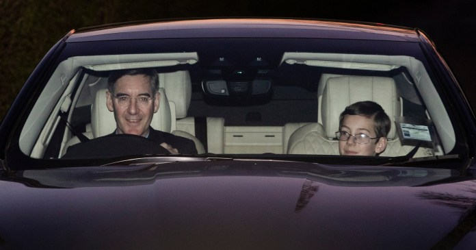 Jacob Rees-Mogg leaving Chequers with his 12 year-old son Peter