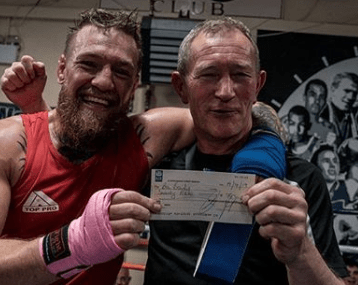 Conor McGregor finally settled an old debt with his former boxing coach