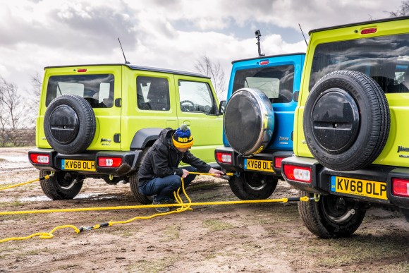 Motors editor Rob hitches up the Jimnys as they prepare to pull