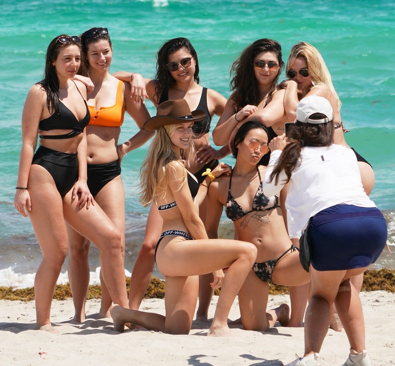 The beach posse pose as they relax on the perfect sand in Miami, Florida