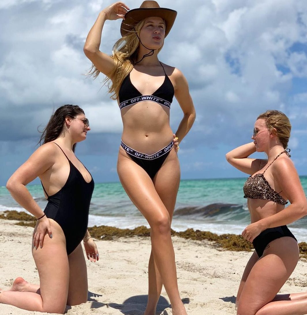 Tennis star Eugenie Bouchard shows she can ranch out into new ideas as she poses with friends in a Western-style Stetson on a beach in Miami