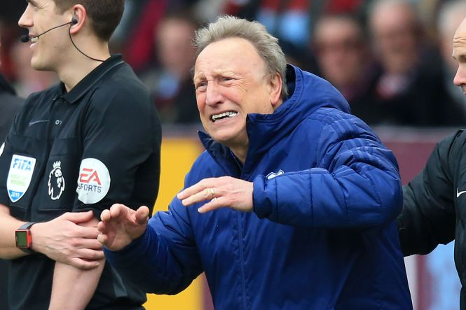 Neil Warnock was left fuming as Cardiff were denied a penalty after initially being awarded it