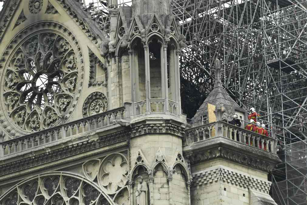 Fire fighters inspect the damage to the cathedral