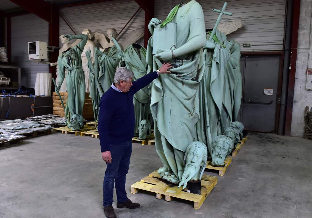 Patrick Palem, expert of the heritage restoration, stands near the statues which sat around the spire of the Notre-Dame
