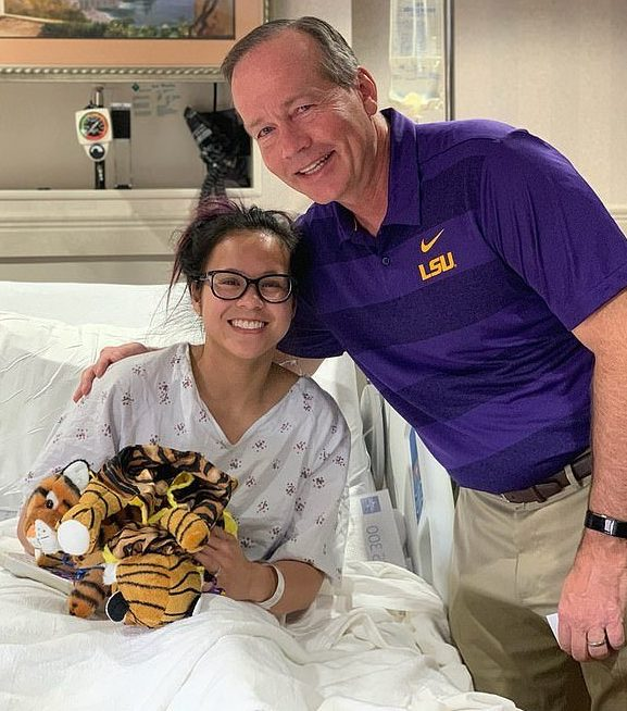 Sam, pictured with Louisiana State University president F King Alexander, underwent surgery on Monday, less than two months before her wedding