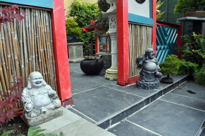 The garden has lots of Buddha statues