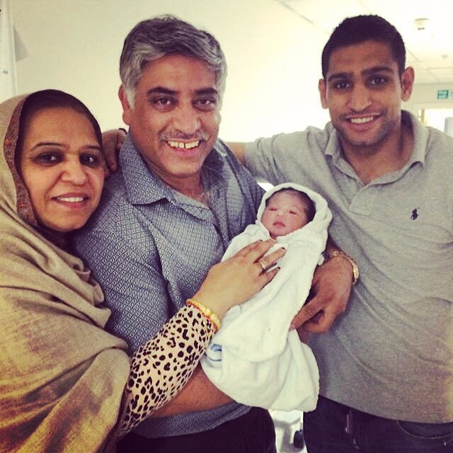Amir with his parents after his second daughter, Alayna was born