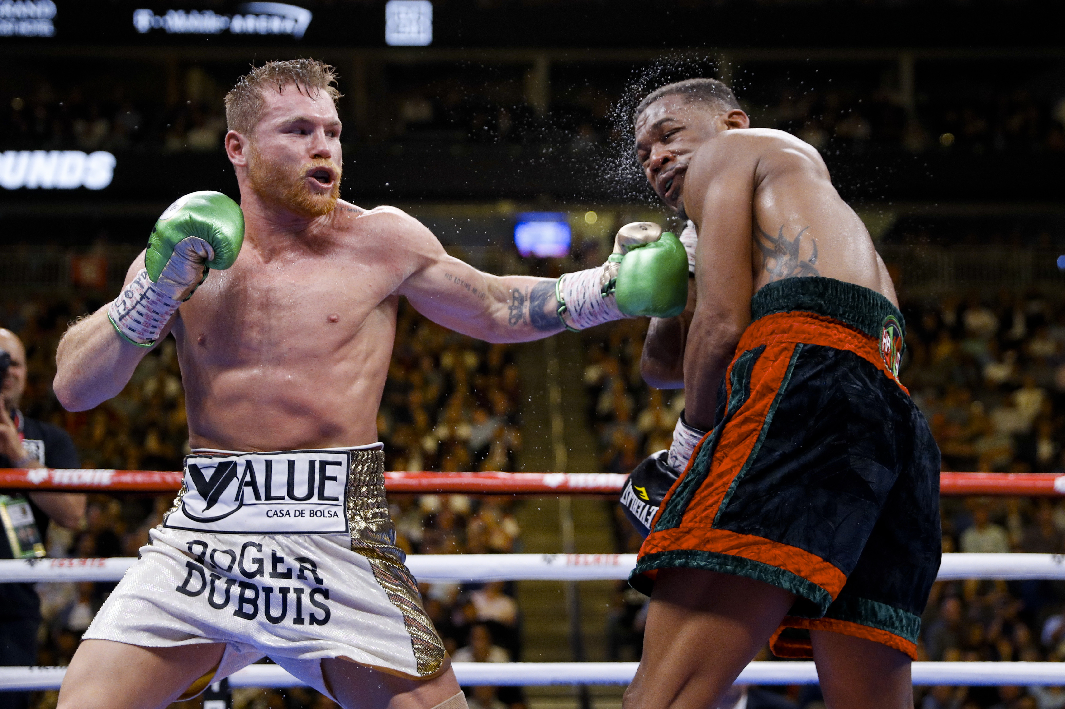 Canelo Alvarez added the IBF middleweight titles to his WBA and WBC belts after defeating Daniel Jacobs