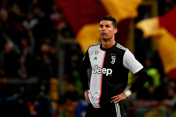 b66607f98 AFP or licensors. Cristiano Ronaldo in Juventus  divisive new home kit   caption