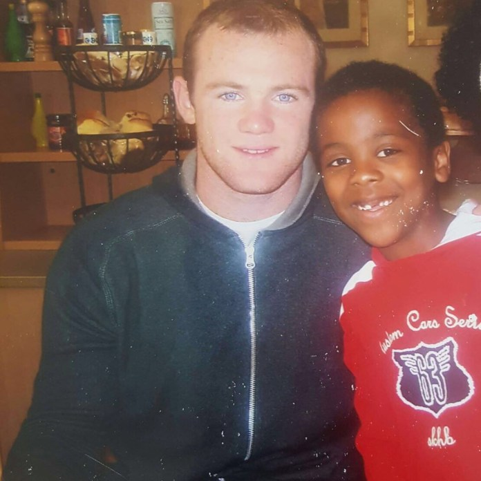 Gomes with Wayne Rooney - who he would later come on for to make his debut