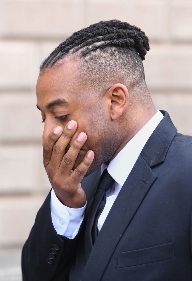 The singer puts his hand to his face as he leaves court