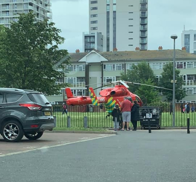 A helicopter can be seen at Tower Hamlets today after a man in his 30s was stabbed to death