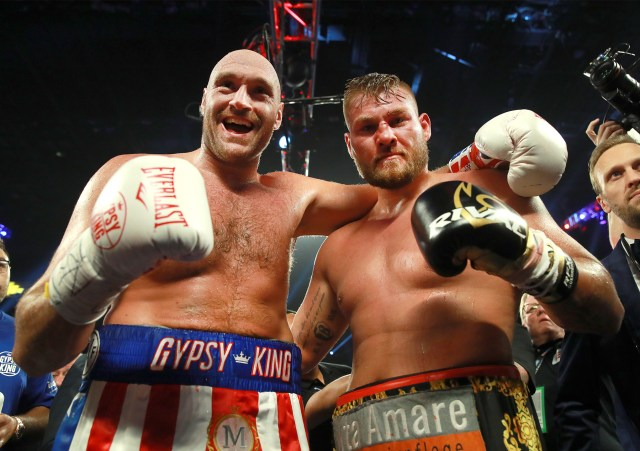 Tyson Fury celebrates with Tom Schwarz after their fight in Las Vegas