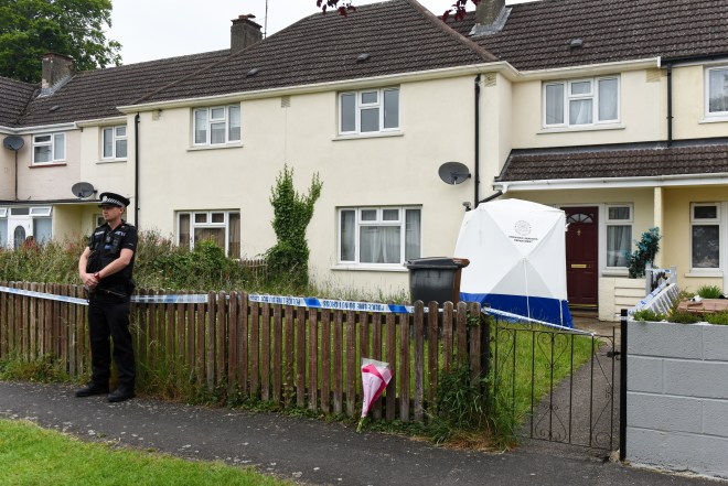 Police stand guard outside the Andover home where the mum was found