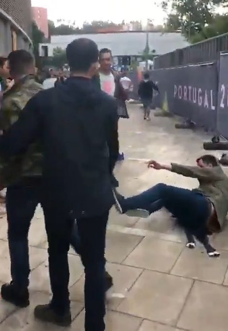 The man was sent sprawling to the ground after the attack in Guimaraes, Portugal