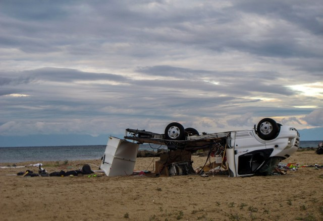 An overturned vehicle is seen on a beach at Sozopoli