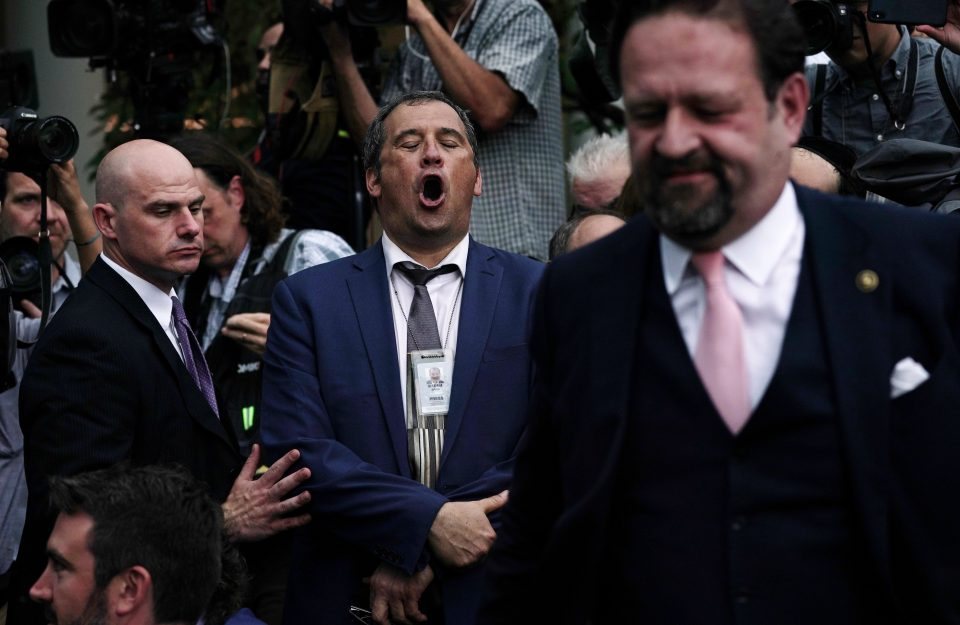 The Secret Service had to step in as Brian Karem (centre), who writes for CNN and Playboy, clashed with Gorka