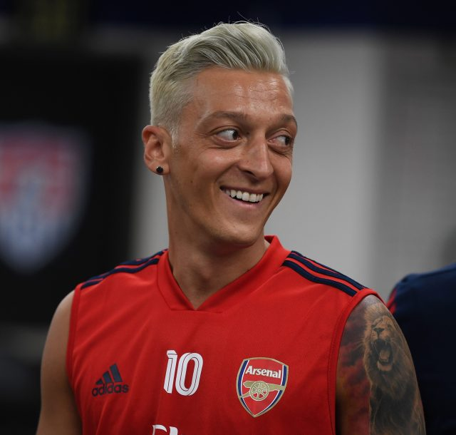 mesut ozil shows off new blond hairdo… but arsenal fans