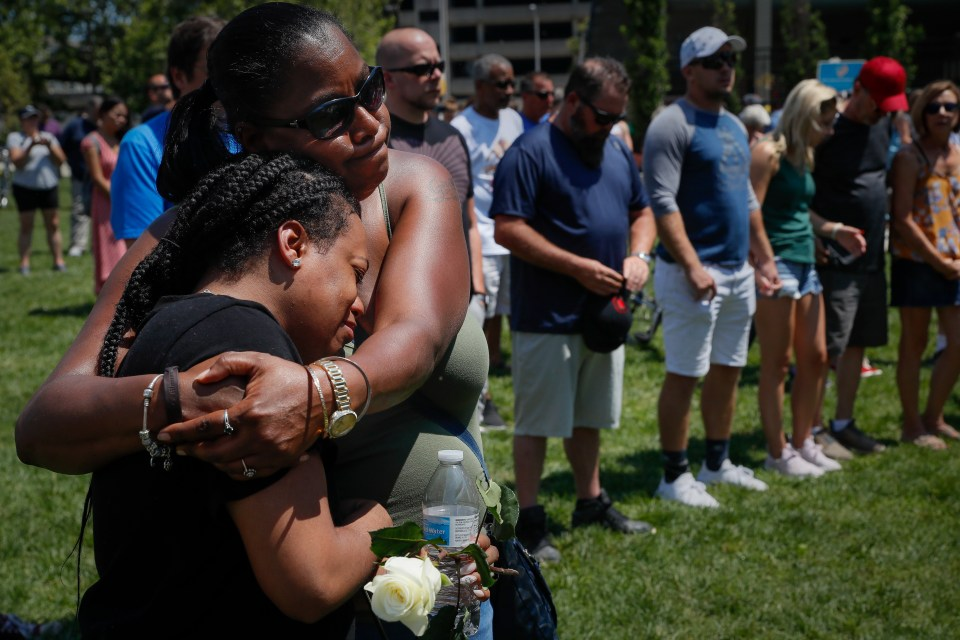 Mourners gather at a vigil in Dayton less than 24 hours after a mass shooting in Oregon district of the town