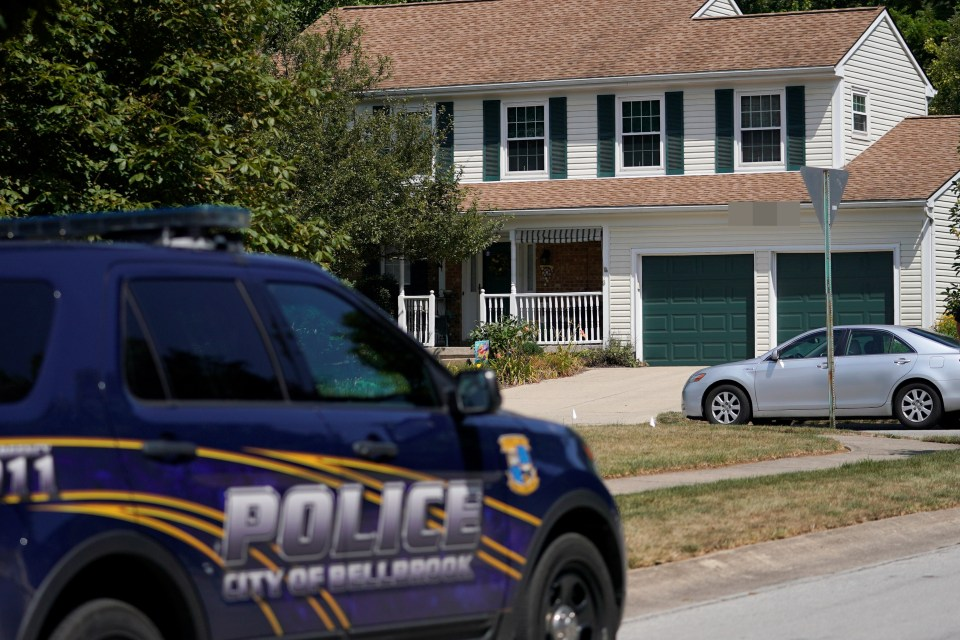 A patrol car sits outside Betts' family home