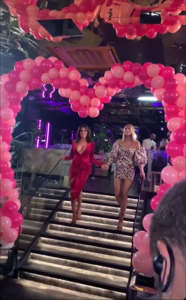 The pair entered the dating show's wrap party hand-in-hand