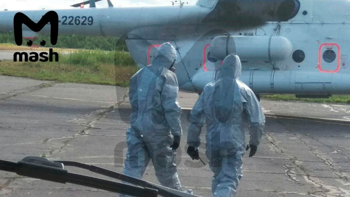 Paramedics were spotted wearing special chemical protection suits when they treated the victims