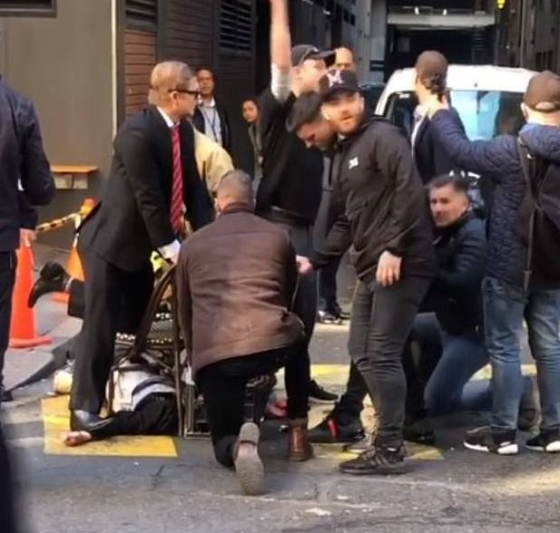 Paul O'Shaughnessy, seen in a black cap, was seen among the crowds rushing to pin the man to the ground after he prowled through the Sydney city centre with a knife