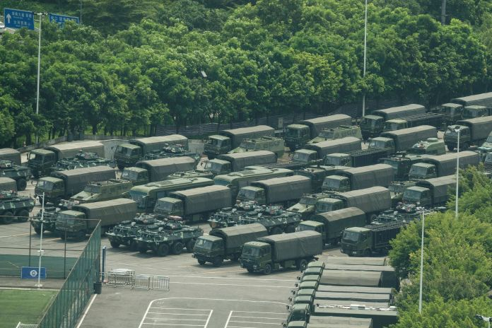 Hundreds of military vehicles could be seen parked near the border of Hong Kong