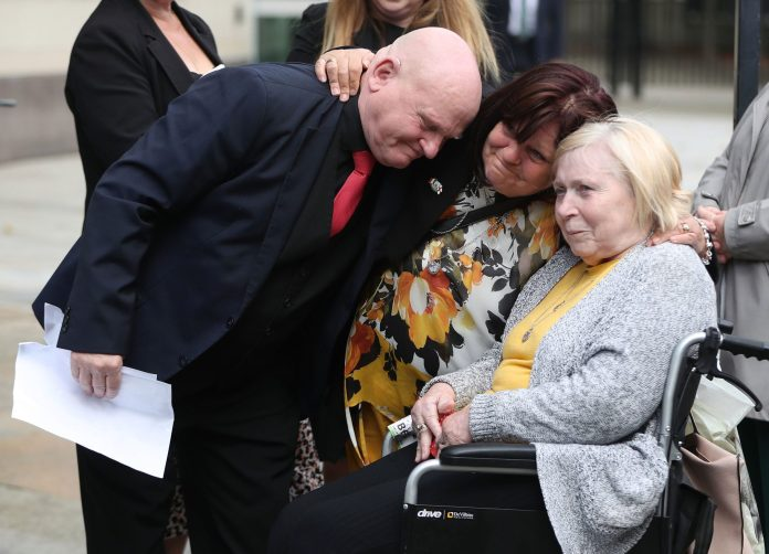 Danny hugged sisters Martina Davis and May McDaid outside the court