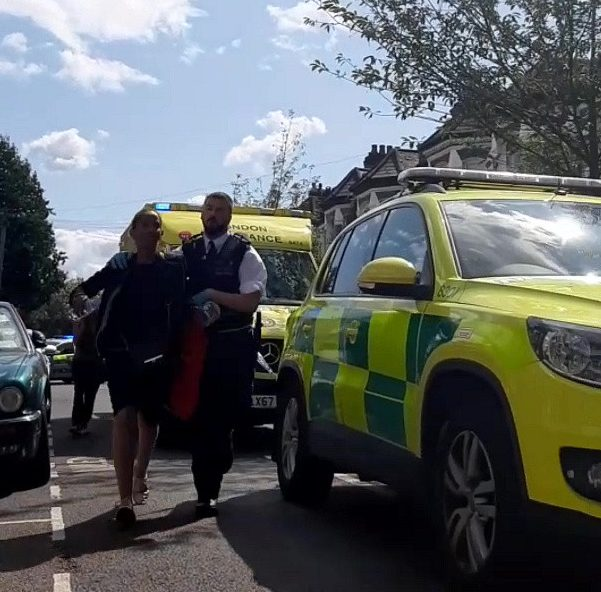 A mum is seen wailing after her son was fatally stabbed in Brixton, London