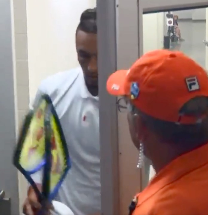 Nick Kyrgios returns with his bent double - two rackets he smashed on a toilet break