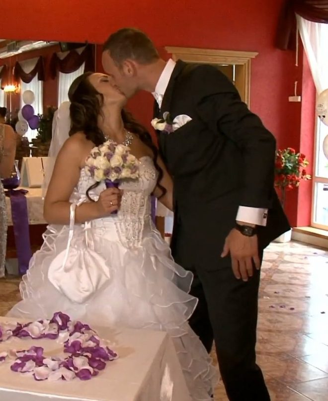 Lana Nemceva, 23, and Kiril Nemcev, 32, kiss on their wedding day