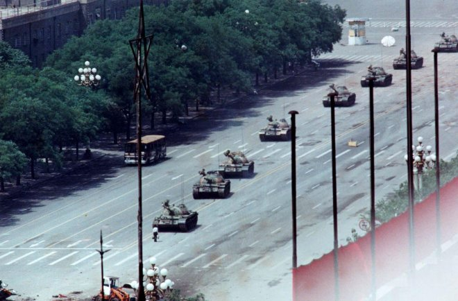 Four photographers captured the moment a lone protester stood in the way of a column of tanks