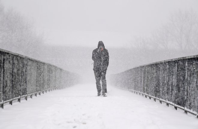 A man in Glasgow makes his way through the snow as sub-zero temperatures hit the UK last winter