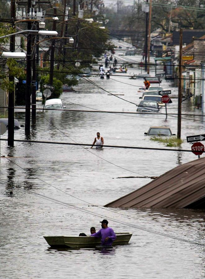 Residents wade through a flooded street in New Orleans after hurricane Katrina made landfall