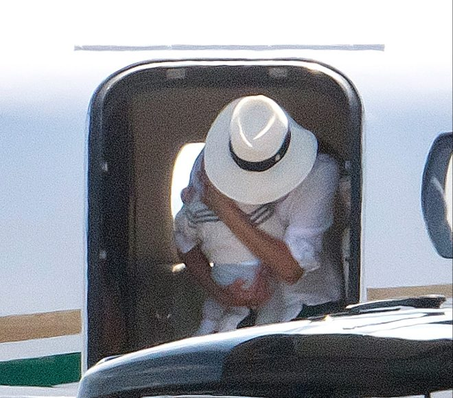 Meghan cradles Archie on a private jet trip, despite saying he was too young to go to Balmoral