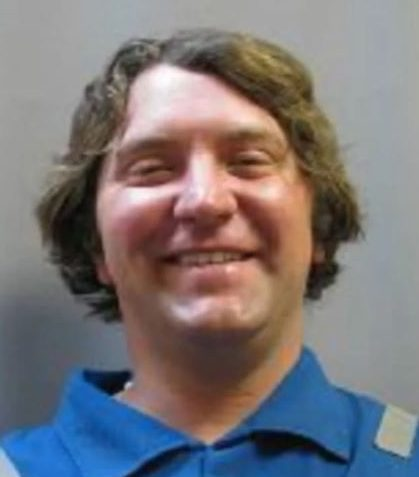 Texas shooter Seth Aaron Ator, 36, is seen grinning in a police mugshot from 2001