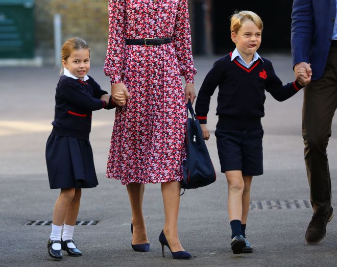 The four-year-old girl holds her mum's hand as they arrive